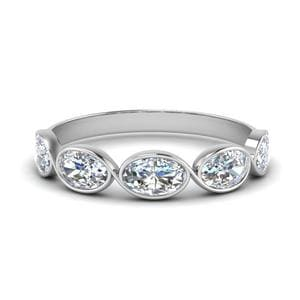 1.25 Ct. Oval Diamond Bezel Set Wedding Band In 14K White Gold