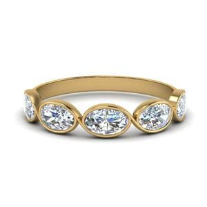 1.25 Ct. Oval Diamond Bezel Set Wedding Band In 14K Yellow Gold