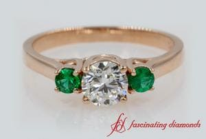 3 Stone Round Diamond Ring With Emerald In Rose Gold