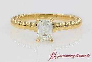 Beaded Emerald Cut Diamond Ring In Yellow Gold