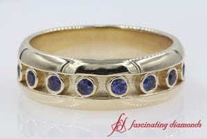 Customized Bezel Sapphire Mens Wedding Band In Gold