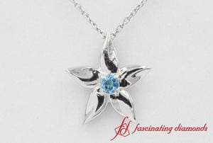 Daisy Blue Topaz Solitaire Pendant In White Gold