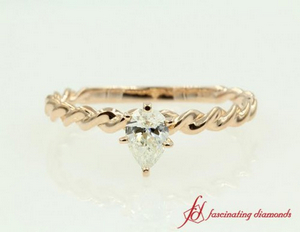 Gold Solitaire Ring With Twisted Band