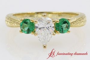 Pear Shaped Diamond Engagement Rings With Emerald Accents