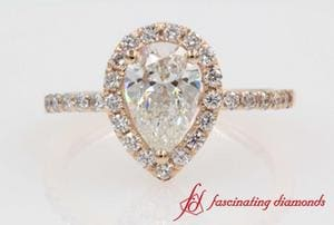 Halo Pear Diamond Engagement Ring In Rose Gold