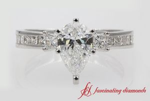 Pear Cut Channel 3 Stone Engagement Ring In 18K White Gold