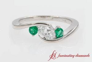 Twist 3 Stone Emerald Ring