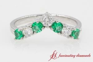 V Design 7 Stone Anniversary Band With Emerald In Platinum