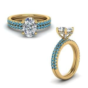 Blue Topaz Prong Oval Shaped Diamond Petite Bridal Set In 18K Yellow Gold