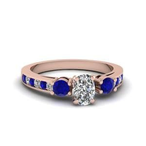 Cushion Cut Channel Three Stone Diamond Ring With Blue Sapphire In 14K Rose Gold