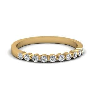 Delicate Floating Diamond Wedding Band In 18K Yellow Gold