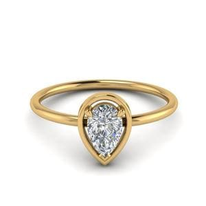 Delicate Pear Diamond Solitaire Ring