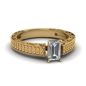 Antique Carved Emerald Cut Solitaire Engagement Ring In 14K Yellow Gold