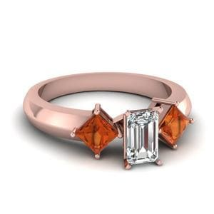 Kite Set 3 Stone Emerald Cut Engagement Ring With Orange Sapphire In 18K Rose Gold