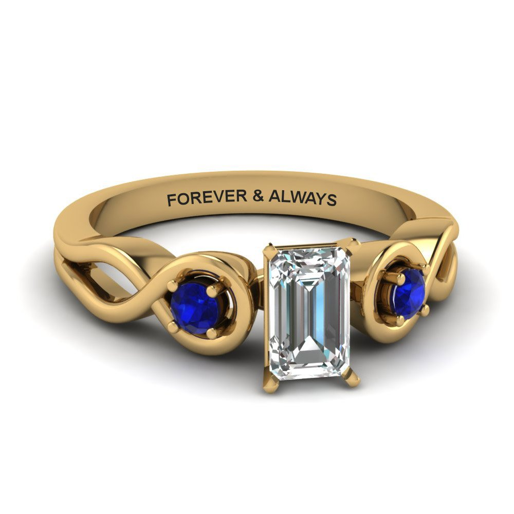 Emerald Cut Engraved Three Stone Diamond Engagement Ring With Blue Sapphire In 14K Yellow Gold