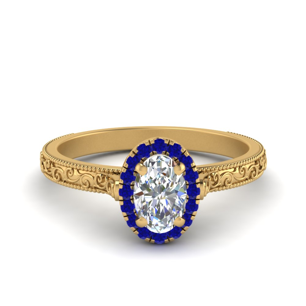 Hand Engraved Oval Shaped Halo Diamond Engagement Ring With Sapphire In 14K Yellow Gold