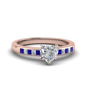 Heart Shaped Channel Princess Cut Diamond Enagagement Ring With Blue Sapphire In 18K Rose Gold