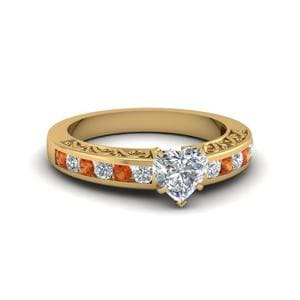 Heart Shaped Channel Set Diamond Vintage Engagement Ring With Orange Sapphire In 14K Yellow Gold