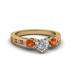 Heart Shaped Channel Three Stone Diamond Ring With Orange Sapphire In 14K Yellow Gold