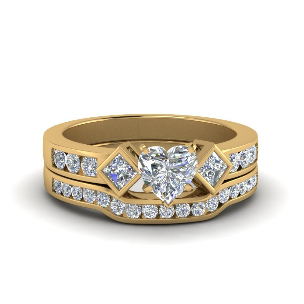 Heart Shaped Three Stone Diamond Ring And Channel Band In 14K Yellow Gold