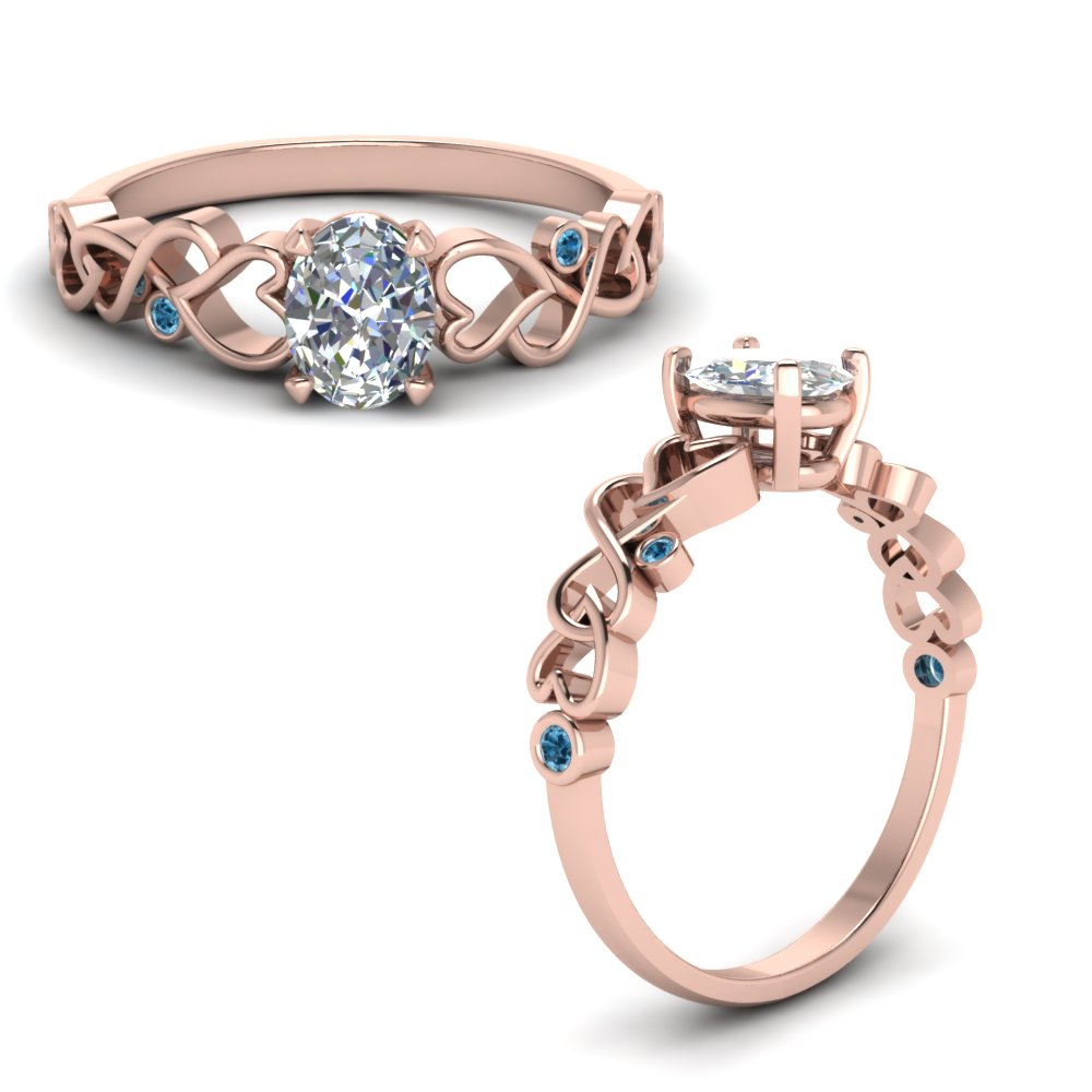 Intertwined Filigree Oval Shaped Engagement Ring With Blue Topaz In 18K Rose Gold