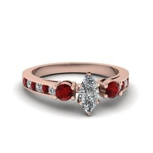 Marquise Cut Channel Three Stone Diamond Ring With Ruby In 18K Rose Gold