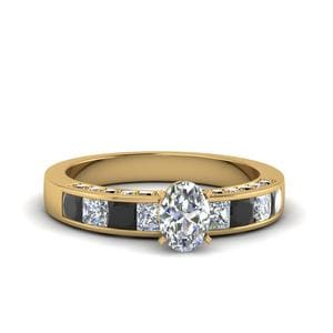 Oval Shaped Channel Engagement Ring With Black Diamond In 14K Yellow Gold