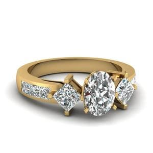 Oval Shaped Diamond Adjoined Shank Sidestone Ring In 14K Yellow Gold