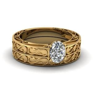 Carved Oval Diamond Solitaire Wedding Ring Set In 18K Yellow Gold