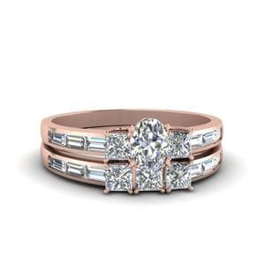 Oval Shaped Diamond Channel Baguette And Princess Accent Stone Wedding Set In 14K Rose Gold