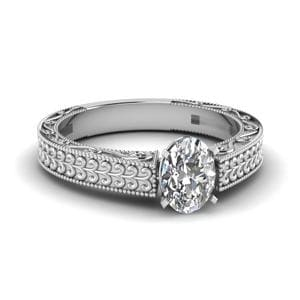 Antique Carved Oval Shaped Solitaire Engagement Ring In 18K White Gold
