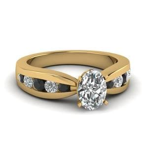 Tapered Channel Set Oval Engagement Ring With Black Diamond In 18K Yellow Gold