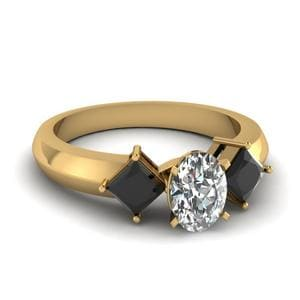 Kite Set 3 Stone Oval Shaped Engagement Ring With Black Diamond In 18K Yellow Gold