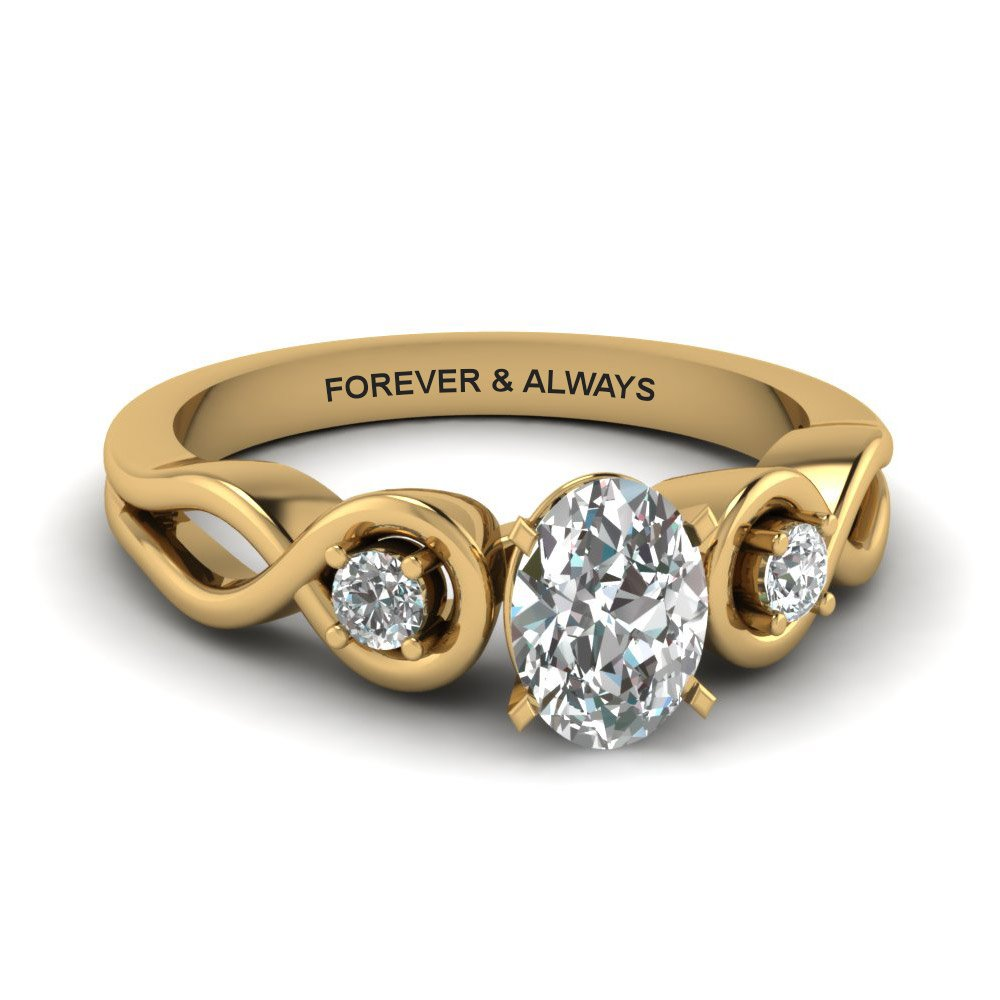 Oval Shaped Engraved Three Stone Diamond Engagement Ring In 18K Yellow Gold