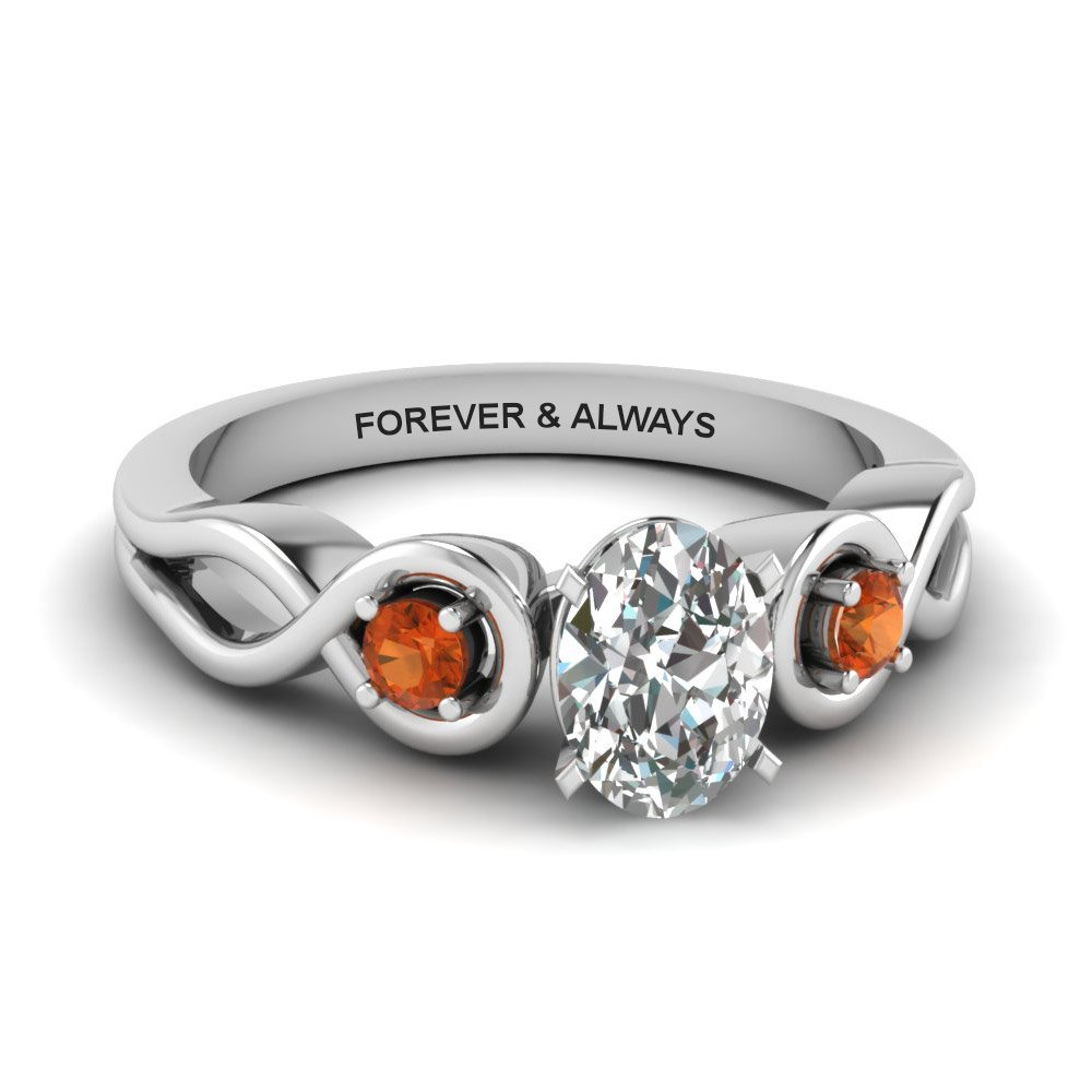 Oval Shaped Engraved Three Stone Diamond Engagement Ring With Orange Sapphire In 14K White Gold
