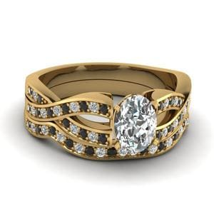 Oval Shaped Entwined Pave Bridal Set With Black Diamond In 18K Yellow Gold