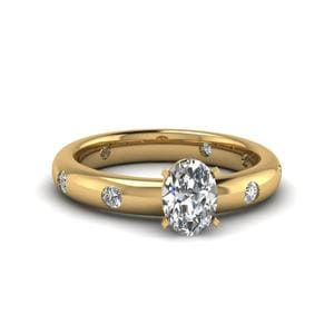 Flush Set Oval Shaped Diamond Engagement Ring In 14K Yellow Gold