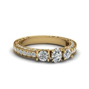 Oval Shaped Stone Accented U Prong Diamond Vintage Engagement Ring In 18K Yellow Gold