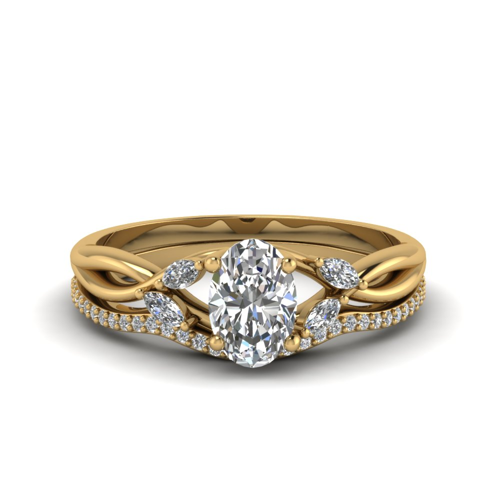 Oval Shaped Twisted Diamond Bridal Set In 14K Yellow Gold