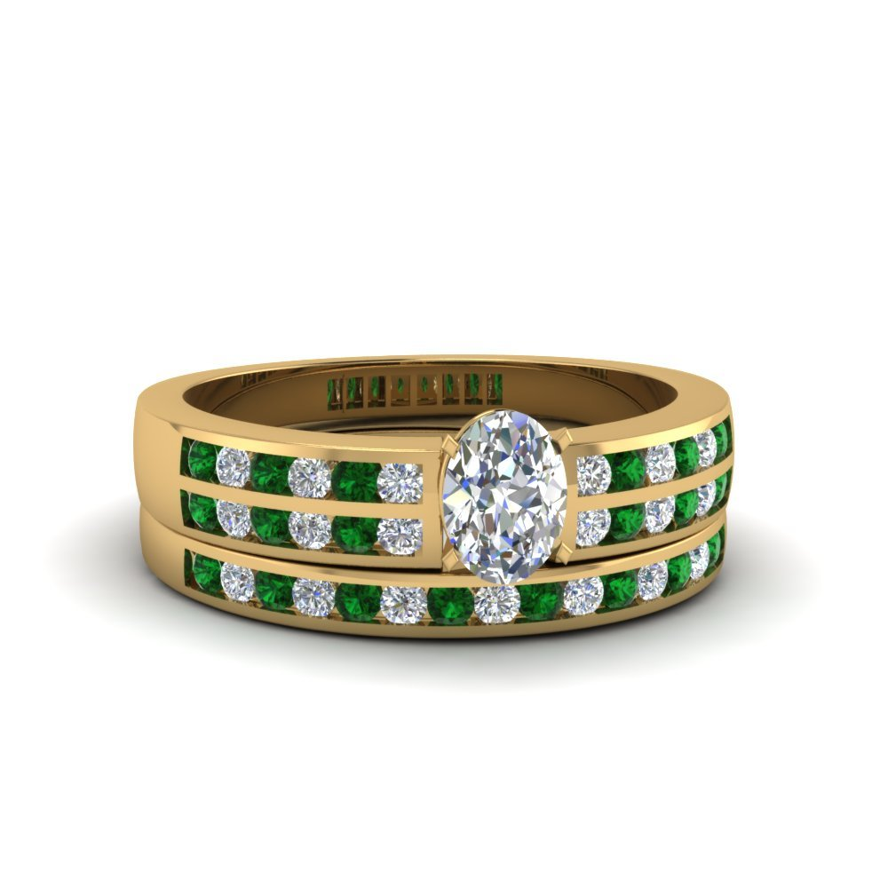 Oval Shaped Two Row Channel Diamond Bridal Set With Emerald In 14K Yellow Gold