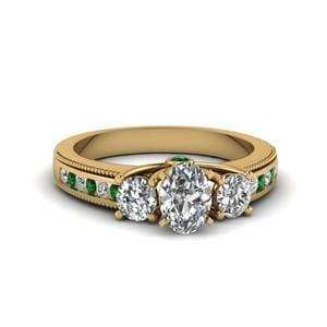 Emerald Side Stone Engagement Ring