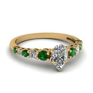 Graduated Pear Diamond Ring With Emerald In 18K Yellow Gold