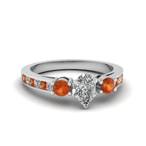 Pear Shaped Channel Three Stone Diamond Ring With Orange Sapphire In 14K White Gold