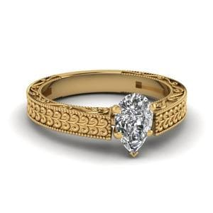 Antique Carved Pear Shaped Solitaire Engagement Ring In 18K Yellow Gold