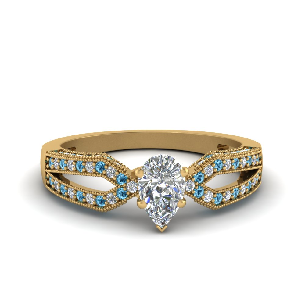 Antique Split Pave Pear Shaped Diamond Engagement Ring With Blue Topaz In 18K Yellow Gold
