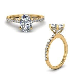 Prong Oval Shaped Diamond Petite Engagement Ring In 14K Yellow Gold