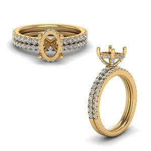 Prong Oval Shaped Diamond Petite Bridal Set In 14K Yellow Gold