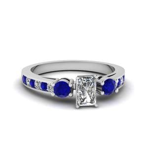 Radiant Cut Channel Three Stone Diamond Ring With Blue Sapphire In 950 Platinum
