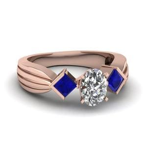 Half Bezel 3 Stone Oval Shaped Engagement Ring With Sapphire In 14K Rose Gold