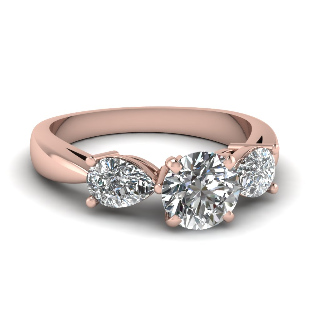 Tear Drop 3 Stone Round Cut Engagement Ring In 14K Rose Gold